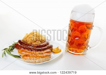 Octoberfest menu beer mug with foam a plate of sausages and sauerkraut. Oktoberfest meal.