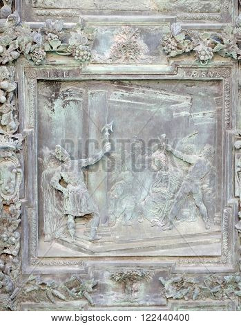 PISA, ITALY - JUNE 06, 2015: PISA, ITALY - JUNE 06, 2015: Christ Crowned with Thorns, sculpture work from Giambologna's school, portal of the Cathedral St. Mary of the Assumption in Pisa, Italy
