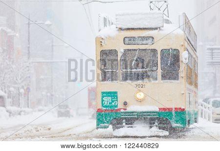 Toyama,Japan -Jan 24:Toyama Railway and Toyama city in snow day on JAN 24,2016 in Toyama,Japan. Toyama Regional Railway is a transportation company in Toyama. The company is commonly known as Chitetsu