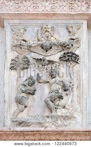 BOLOGNA, ITALY - JUNE 04: Baptism of Christ by Lazzaro Casario, right door of San Petronio Basilica in Bologna, Italy, on June 04, 2015