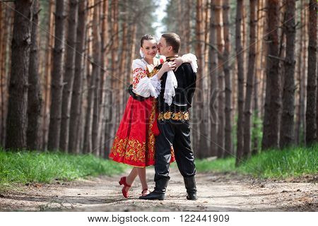 Man and woman with an accordion in the Russian national dress