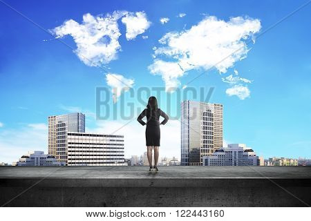 Back View Of Business Woman Looking At World Shape Cloud