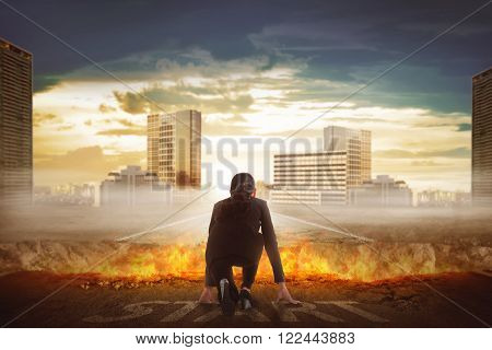 Back view of asian business woman start running over broken road with fire