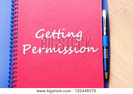 Getting permission text concept write on notebook with pen