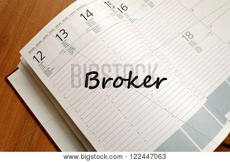 Broker text concept write on notebook .