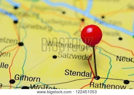 Photo of pinned Stendal on a map of Germany. May be used as illustration for traveling theme.