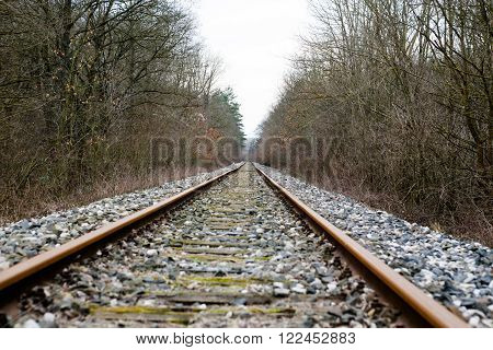 Railway tracks and gravel leading into the distance