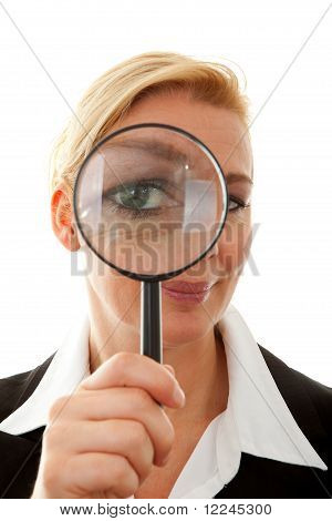 Business Woman With Magnifying Glass To The Eye