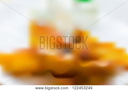 Abstract blurry, blurred vector background of potatoes, cream and plate. Soft focus background, element