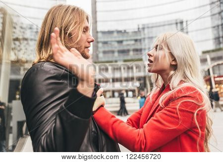 Couple fighting in an urban area of the city. Concept about relationship problems ** Note: Visible grain at 100%, best at smaller sizes