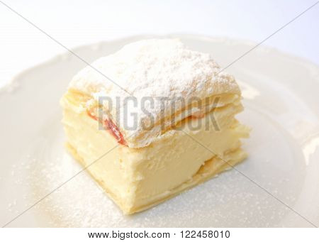 Sweet dessert of puff pastry and vanilla pudding
