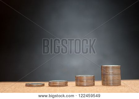 Stacks of coins. The increase in money