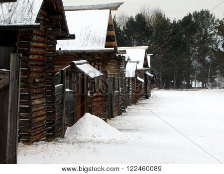 Winter in russian museum, where exposition shows tradittional log house