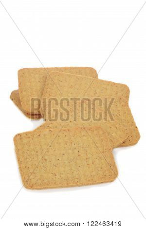 closeup of whole wheat cookie on white background