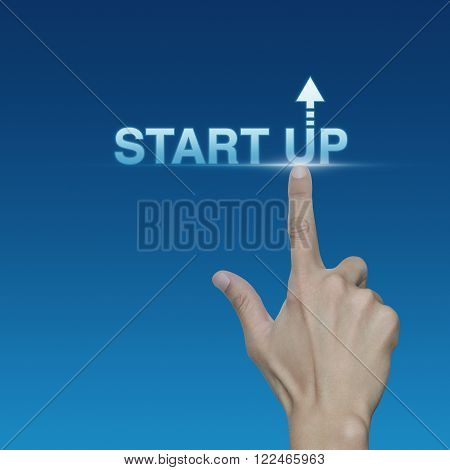 Hand click on start up icon over blue background Start up business concept