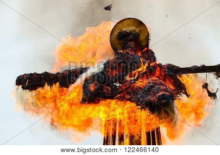 Burning down scarecrow of Shrovetide during Shrovetide celebrations