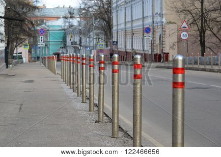 Moscow, Russia. Fence of the columns along the road in the alley Gorokhovskii