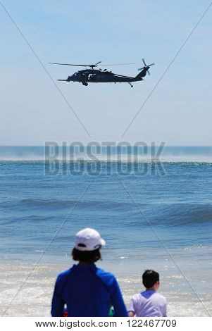 JONES BEACH - MAY 30: Audiences and US Army UH-60 Black Hawk helicopter over sea on Jones Beach Air Show on May 30, 2010 in Jones Beach, New York.
