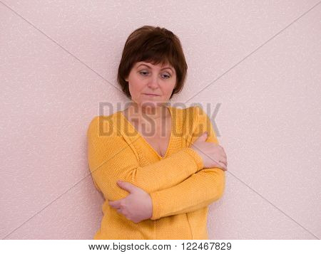 Portrait of attractive mature sad woman looking down