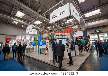 HANNOVER GERMANY - MARCH 14 2016: Booth of Scheer company at CeBIT information technology trade show in Hannover Germany on March 14 2016.