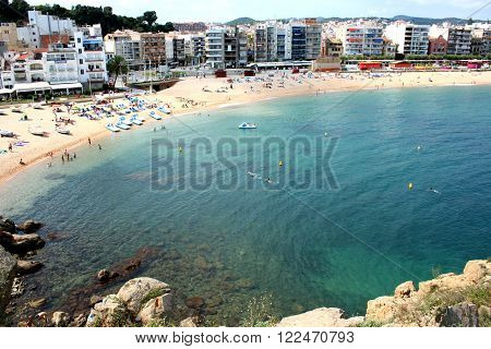 Blanes, Spain - July 31, 2011: Beach Blanes view, Costa Brava, Catalonia, Spain. Blanes is a town in Catalonia and most popular holiday resorts on the Costa Brava