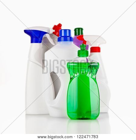 Various bottles with cleaning supplies isolated on white background