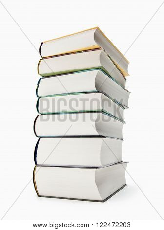 Untidy Stack Of Colorful Paperback Book on white background
