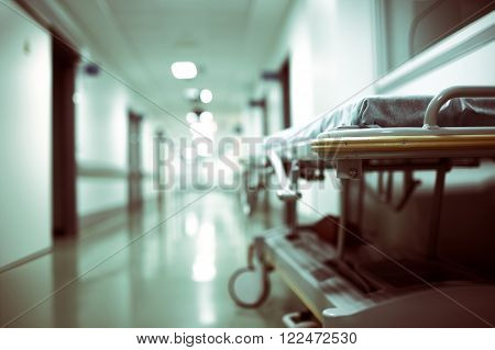 Empty gurney in a long hospital corridor