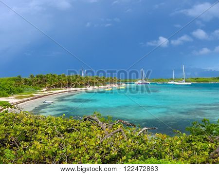 Spectacular turquoise bay with stormy sky in Guadeloupe, French West Indies, Caribbean.