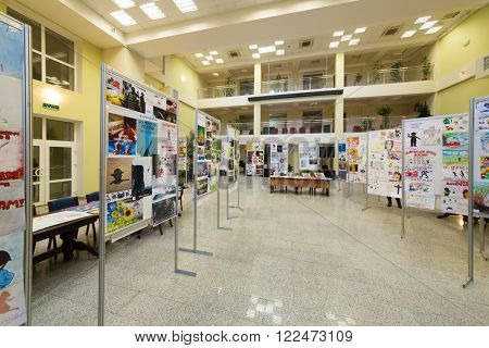 RUSSIA, MOSCOW - 10 DEC, 2014: Many pictures on stands at exhibition in Training center for civil defense and emergency situations of Moscow.