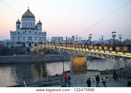 RUSSIA, MOSCOW - 12 APR, 2015: Cathedral of Christ the Saviour and Patriarshy Bridge over the Moskva River.