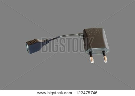 AC adapter with USB. Isolate on gray background