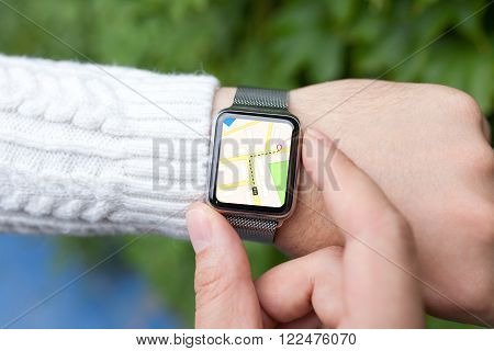 man hand and smart watch with map in the screen on the street