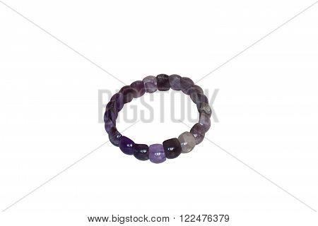 Bracelet made of amethyst, cloves. Isolate on white background