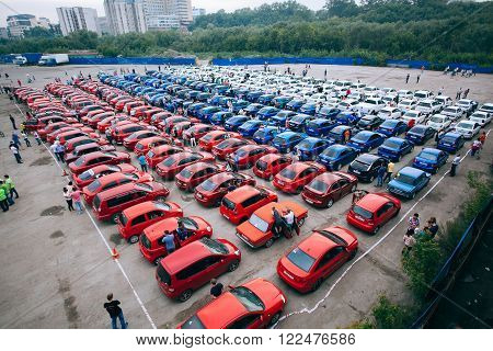 Omsk, Russia - August 22, 2014: Automobiles flashmob. Country flag by cars colored in red, blue and white