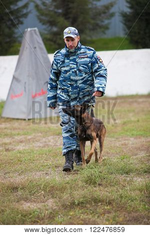 Omsk, Russia - August 22, 2014: Canine Center.  German shepherd train with policeman