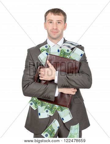 Businessman holding briefcase full of money isolated on white background