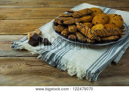 Various chocolate chip cookies on a wooden background. Breakfast cookies. Dessert cookies. Cookies. Cookie. Dessert. Breakfast. Sweet cookies. Homemade cookies