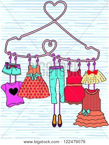 Woman dresses on a hanger and accessories set.