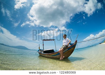 Young tourist on the boat in Diep Son island in Khanh Hoa province, Vietnam.