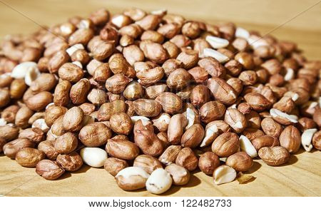large pile of peanuts on the table closeup