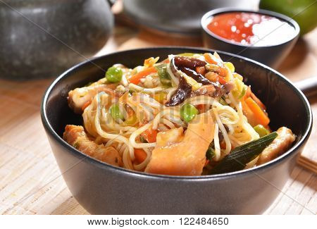 Tasty asian meal Chicken with Rice Noodles and Vegetables