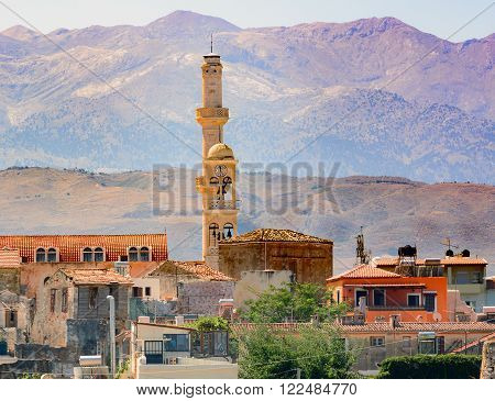 Belltower of Chania town and mountains on the background at Crete island.