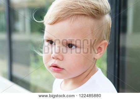 Outdoor Portrait Of Cute Caucasian Blond Baby Girl