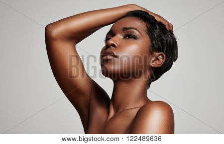 black woman's portrait on a grey background