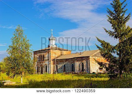 Small brick orthodox church in Russia summer day