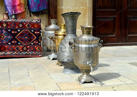 On a photo are represented ancient iron exotic and ecological ware which use centuries.