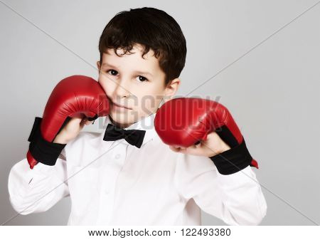 Boy In White Shirt And Bow Tie In Fighting Stance