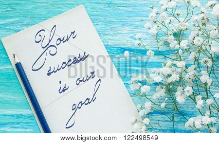 Your Success Is Our Goal Inspirational quote  turquoise wooden background