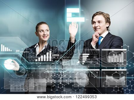Young businessman and businesswoman working in cooperation with virtual panel